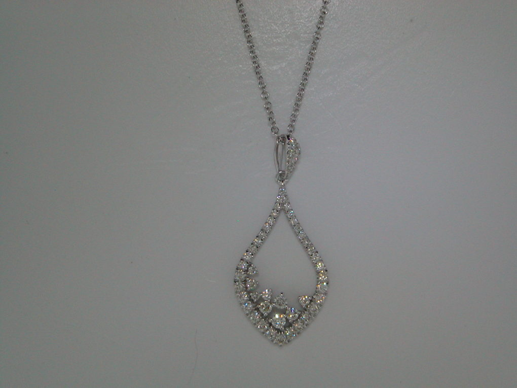 Diamond pendant set in 14kt white gold with 45 diamonds =.58ct with an 18in adjustable chain  style 405-0178 $1700.00