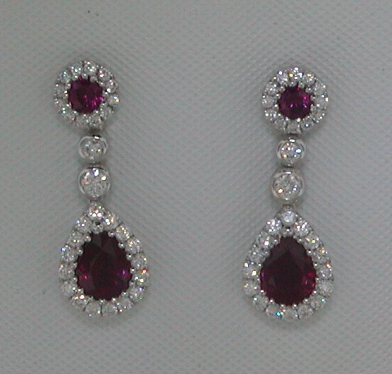 .92ct ruby earrings set in 18kt white gold with 60 diamonds =.38ct style 223-0185 $3650.00