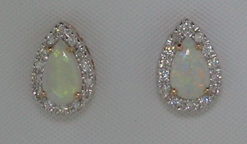 .93ct opal earrings set in 14kt rose gold with 28 diamonds =.26ct style 223-0189  $1150.00