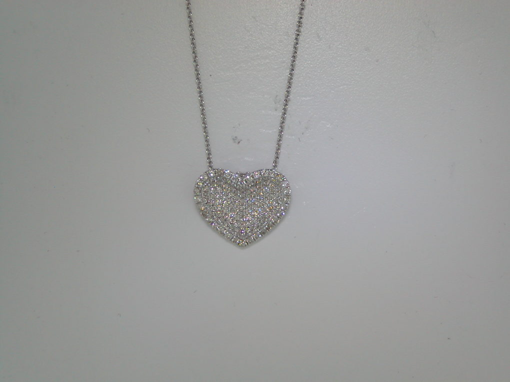 Pave heart pendant set in 14kt white gold with 128 diamonds =.54ct with a 16in rolo chain  style 700-0270  $1300.00