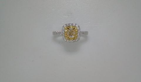 .50ct yellow cushion cut center diamond ladies ring set in 14kt two tone gold with 16 yellow diamonds =.13ct and 26 white diamonds =.34ct  style 700-0300  $3750.00
