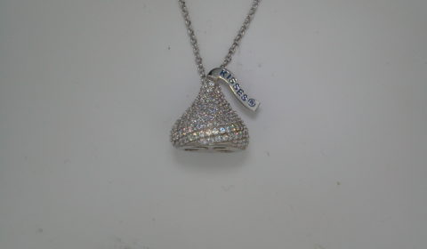 Cubic zirconia Hershey's Kiss necklace 12X13mm set in sterling silver with an 18in chain  style 900-0425  $80.00