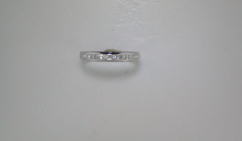 Princess cut anniversary band set in 14kt white gold with 12 diamonds =.24ct  style 200-0579 $950.00