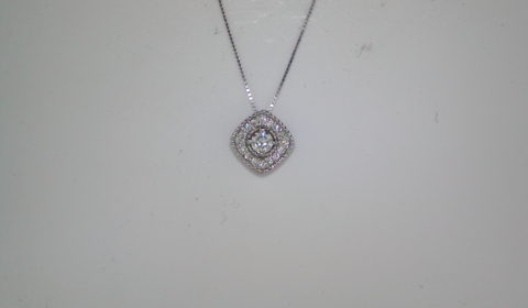 Halo style pendant set in 14kt white gold with 17 diamonds =.28ct with 18in chain style 200-0617 $850.00