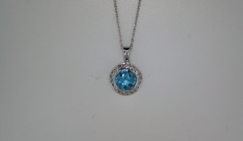 1.09ct blue topaz pendant set in 14kt white gold with 21 diamonds =.25ct  style 500-1365 $2000.00
