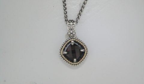 2.38ct garnet pendant set in sterling silver and 14kt yellow gold with a 20in chain  style 800-1648  $225.00
