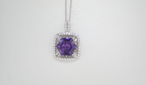 3.61ct amethyst pendant set in 18kt white gold with 49 diamonds =.47ct  style 500-2065 $2000.00