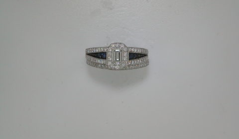 .41ct Emerald cut diamond set in 14kt white gold with 4 sapphires =.11ct and 134 diamonds =.70ct  Style 431-0004  $3350.00