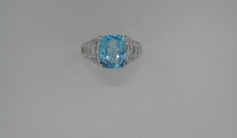 5.52ct Blue topaz cushion cut ladies ring set in 14kt white gold with 64 diamonds =.32ct  Style 950-0079  $2250.00