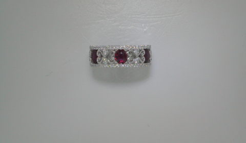 1.15ct Ruby ladies ring in 18kt white gold with 66 diamonds =.59ct and 3 rubies.  Style  135-0133  $4500.00