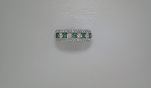 Emerald ladies ring set in 18kt white gold with 5 emeralds =.48ct and 46 diamonds =.51ct   Style 135-0134  $2950.00