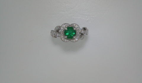 1.13ct Emerald ladies ring set in 14kt white gold with 48 diamonds =.45ct  Style 135-0135  $4950.00