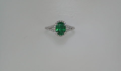1.55ct emerald ladies ring set in 14kt white gold with 48 diamonds =.40ct  Style 135-0136  $6950.00