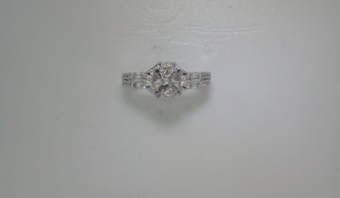 Semi-mount engagement ring in 14kt white gold with 8 baguettes and 40 round diamonds =.60ct  Style 135-0143 $2400.00