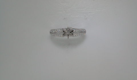 Semi-mount engagement ring in 14kt white gold with 36 diamonds =.35ct  Style 135-0144 $1800.00