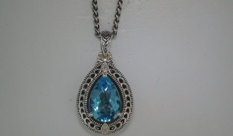 6.18ct blue topaz pendant in sterling silver and 14kt yellow gold with one diamond =.01ct and 18in chain  Style 800-1803 $325.00