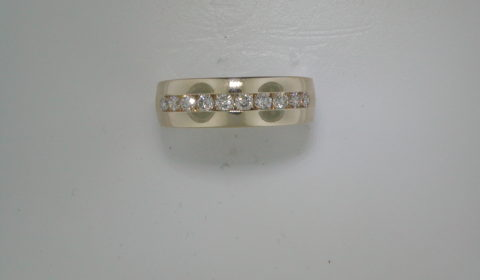 Gents wedding ring in 14kt yellow gold 8mm wide with 10 channel set diamonds =1.00ct  Style 750-0606  $3650.00
