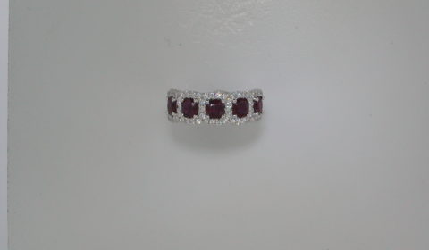 Ladies 1.59ct ruby ring set in 18kt white gold with 58 diamonds =.49ct and 5 rubies Style 135-0153  $5250.00