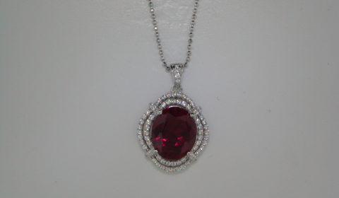 Red corrundum oval cut pendant set in sterling silver with CZs and an 18in chain  Style 625-0042  $215.00