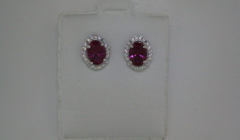 Red corrundum oval cut earrings set in sterling silver with CZs  Style 625-0054  $150.00