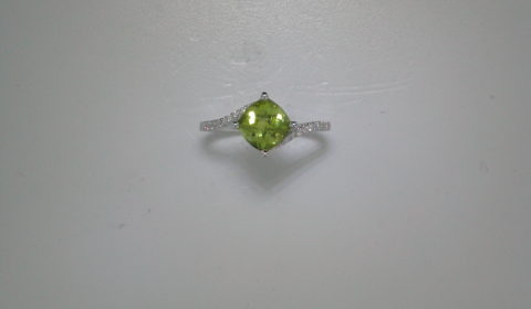 Checkerboard cut peridot ring =1.61ct set in 14kt white gold with 22 diamonds =.11ct  Style Y371618RWPD $800.00
