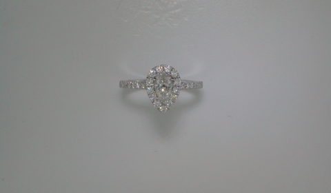 Pear shape engagement ring =.50ct set in 14kt white gold with 31 diamonds =.49ct  Style 700-0325  $3995.00