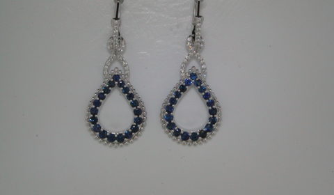 1.52ct blue topaz earrings set in 14kt white gold with 64 diamonds =.22ct Style 842-0020 $2000.00