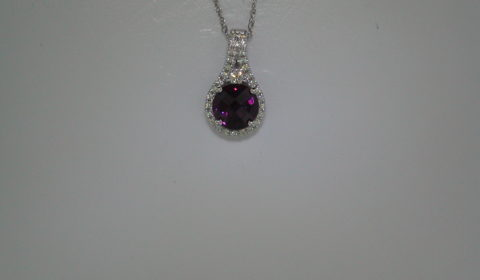 2.70ct Rhodelite pendant set in 14kt white gold with 30 diamonds =.24ct with an 18in chain  Style 650-0067 $1225.00
