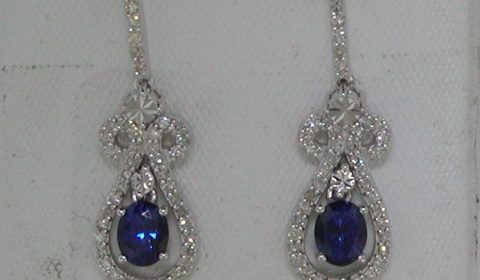 .90ct sapphire earrings set in 14kt white gold with 84 diamonds =.38ct Style 661-0007 $1600.00