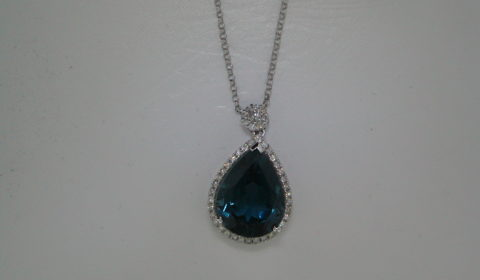 9.56ct London Blue Topaz pendant set in 14kt white gold with 46 diamonds =.53ct  Style 910-0039  $1500.00