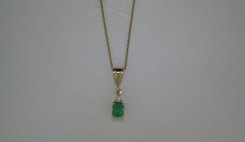 .37ct Emerald pendant set in 14kt yellow gold with diamonds =.03ct  with an 18in chain  Style 750-0620  $650.00
