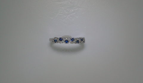 .35ct Sapphire ladies ring set in 14kt white gold with 23 diamonds =.23ct  Style 200-0724 $1200.00