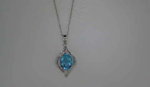 2.13ct Blue topaz pendant set in 14kt white gold with 16 diamonds =.10ct on an 18in chain Style 950-0109 $675.00