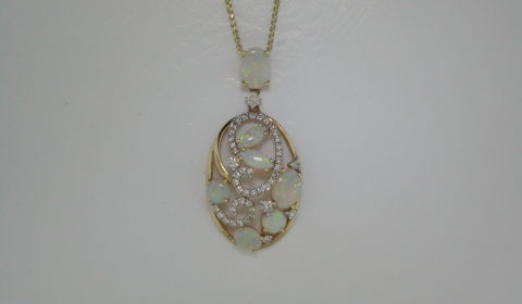 2.14ct Opal pendant set in 14kt yellow gold with 47 diamonds =.80ct on an 18in chain Style 950-0114 $2250.00