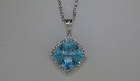 5.50ct Blue Topaz pendant set in 14kt white gold with 32 diamonds =.13ct on an 18in chain Style Y032027PWTP $1050.00