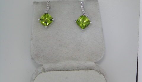 2.64ct Peridot earrings set in 14kt white gold with 18 diamonds =.09ct  Style 950-0120 $750.00