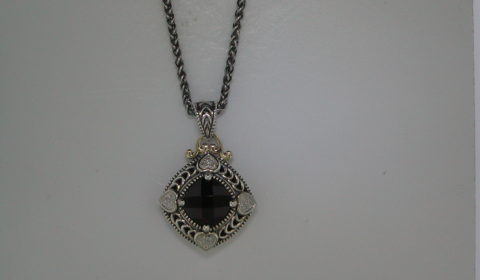 2.27ct Garnet pendant set in sterling silver and 14kt yellow gold with 12 diamonds =.05ct with an 18in chain Style 800-1957 $275.00