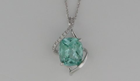 Green Spinel pendant =5.80ct set in 14kt white gold with 14 diamonds =.12ct on an 18in chain  Style SDP1555 $1000.00