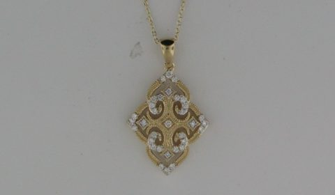 Filigree necklace in 14kt yellow gold with 33 diamonds =.20ct on an 18in chain  Style 842-0026 $1625.00