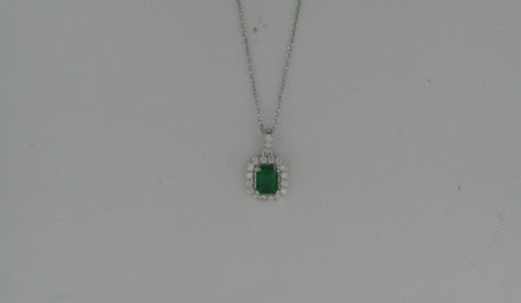 Emerald pendant =.53ct set in 14kt white gold with 20 diamonds =.16ct on an 18in chain  Style 910-0048 $950.00