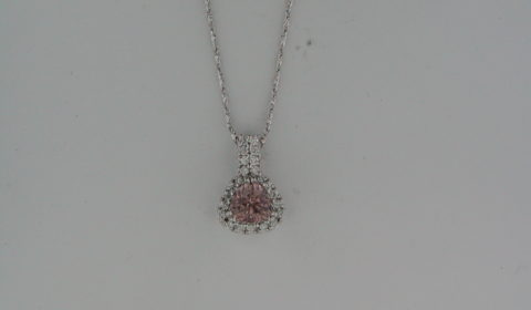 Malaya Garnet pendant =1.30ct set in 14kt white gold with 23 diamonds =.23ct on an 18in chain  Style 926-0065 $1550.00