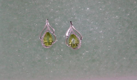 Peridot earrings =1.60ct set in 14kt white gold with 26 diamonds =.12ct  Style 950-0127 $595.00