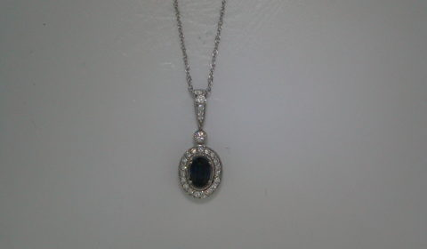 Sapphire pendant =.67ct set in 14kt white gold with 24 diamonds =.25ct with an 18in chain  Style 135-0172  $1550.00