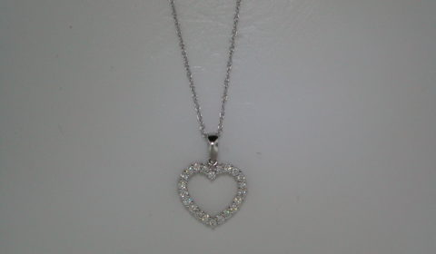 Heart pendant set in 18kt white gold with 22 diamonds =.36ct with and 18in chain  Style 135-0174  $1150.00