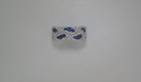 Sapphire ladies ring set in 18kt white gold =.81ct with 132 diamonds =.58ct  Style 135-0177 $3500.00