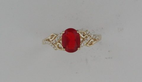 Mexican fire opal ring =.96ct set in 14kt yellow gold with 20 diamonds =.11ct  Style 720-0204 $1550.00