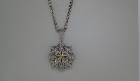 Filigree vintage pendant set in 14kt yellow gold and sterling silver with 12 diamonds =.05ct with an 18in chain Style 800-1956 $175.00