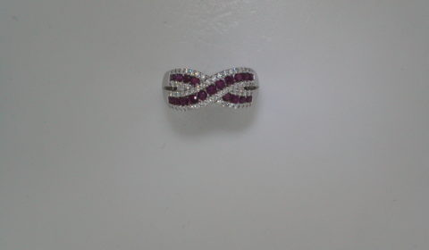 Ladies ruby ring in 14kt white gold, with 19 rubies =1.00ct and 58 diamonds =.33ct.  Style 723-0022 $2400.00