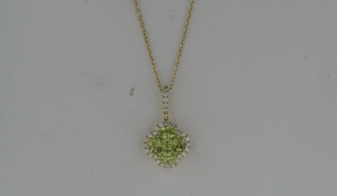 Peridot pendant in 14kt yellow gold with 5 peridot =.86ct and 24 diamonds =.17ct on an 18in chain.  Style 842-0031 $950.00