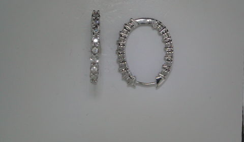 Illusion hoop oval earrings in 14kt white gold with 28 diamonds =.72ct.  Style 412-0094 $2200.00